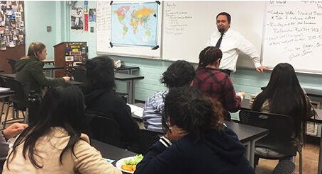 Teacher and sponsor James DeLarme interacts with a group of POPS the Club students at El Camino Real Charter High School.